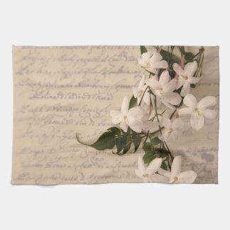 jazmín en la toalla de plato vieja de la escritura