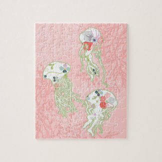 Jelly fishes on pastel pink background. puzzles