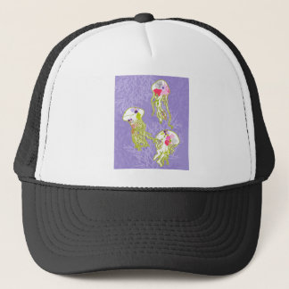 Jelly fishes on pastel violet background. trucker hat