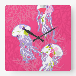 Jelly fishes on plain pink background. wallclocks