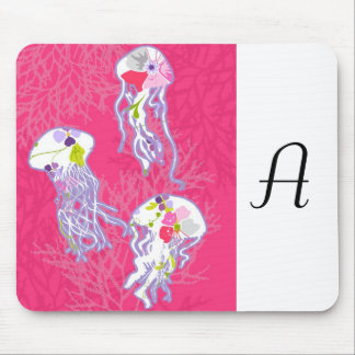 Jelly fishes on plain pink background. mouse pad