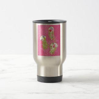Jelly fishes on plain pink background. travel mug