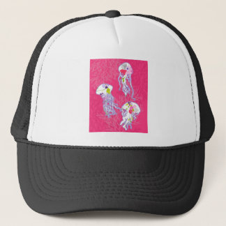 Jelly fishes on plain pink background. trucker hat