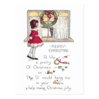 Jeroglífico del navidad con el chica y el gato en tarjeta postal
