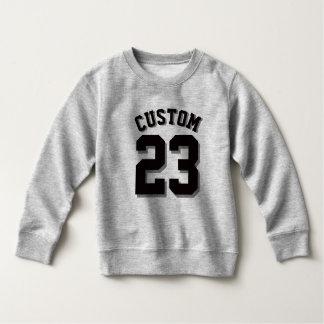 Jersey gris y negro de los deportes del niño el |