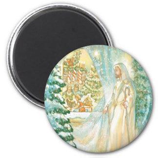 Jesús en el navidad que mira con el velo de la nie imán redondo 5 cm