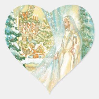 Jesús en el navidad que mira con el velo de la pegatina en forma de corazón