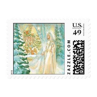 Jesús en el navidad que mira con el velo de la sellos postales