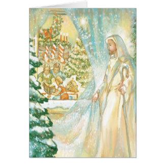 Jesús en el navidad que mira con el velo de la tarjeta de felicitación