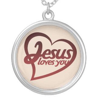 Jesús le ama colgante redondo