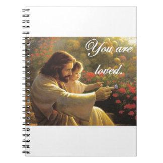 Jesús le aman libro de apuntes con espiral