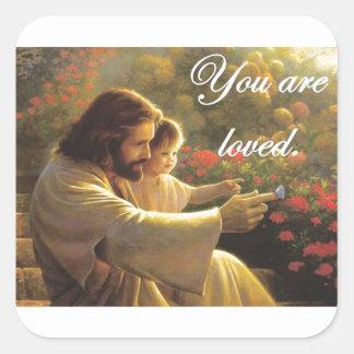 Jesús le aman pegatina cuadrada
