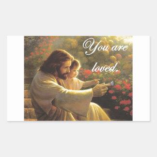 Jesús le aman pegatina rectangular