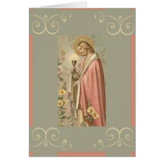 Jesús que lleva a cabo la comunión santa de la tarjeta de felicitación