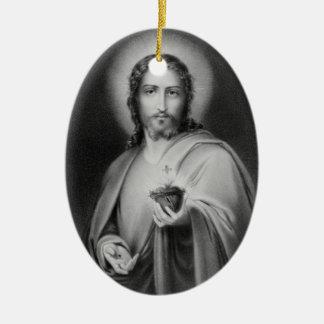Jesús que sostiene un ornamento religioso del adorno ovalado de cerámica