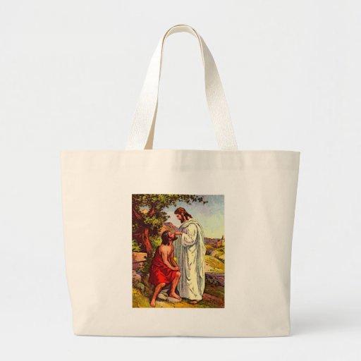 Jesús y el hombre ciego bolsas de mano