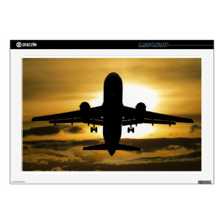 Jet Aircraft Against the Amber Sky Skin For Laptop