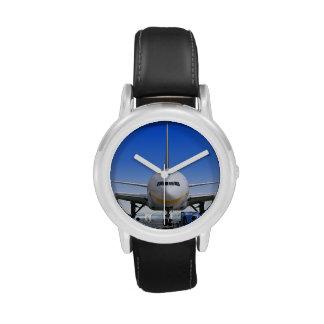 Jet blanco con el taxi azul reloj de mano