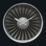 "Jet Engine Turbine Fan Large Clock<br><div class=""desc"">Front view of a modern jet turbine engine showing the fan blades and shiny silver engine cowling.</div>"