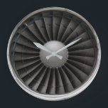 """Jet Engine Turbine Fan Large Clock<br><div class=""""desc"""">Front view of a modern jet turbine engine showing the fan blades and shiny silver engine cowling.</div>"""