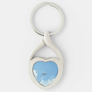 Jet Soaring Through Cloudy Sky Key Chains