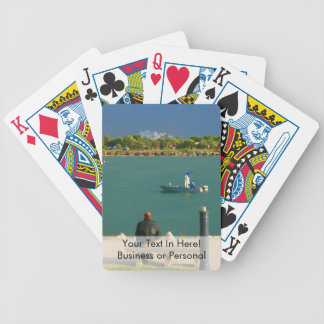 jetty scene in graphic boat man bicycle playing cards