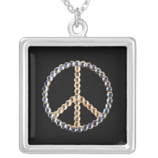 Jeweled peace sign on black background custom jewelry