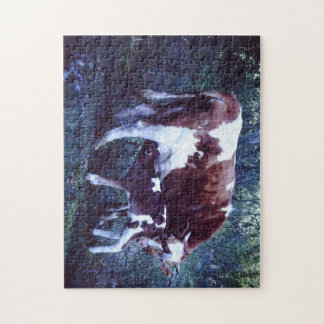 Jigsaw puzzle featuring cow and calf photo.
