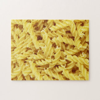 Jigsaw puzzle featuring uncooked rotini pasta