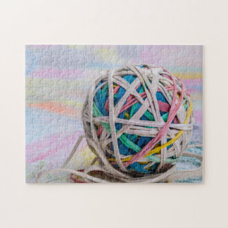 Jigsaw puzzle of a colourful ball of elastic bands