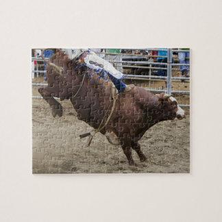Jinete de Bull en el rodeo Rompecabezas