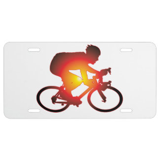 Jinete de la bicicleta de la puesta del sol placa de matrícula