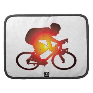 Jinete de la bicicleta de la puesta del sol organizador