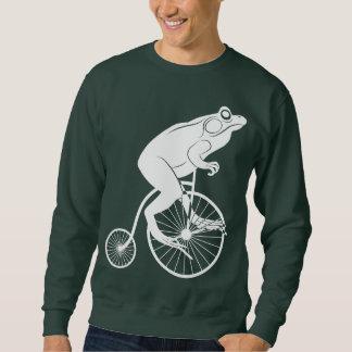 Jinete de la rana en la bici del comino del jersey