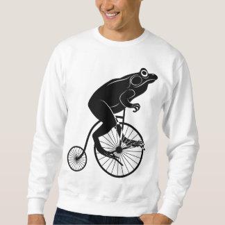 Jinete de la rana en la bici del comino del sudadera