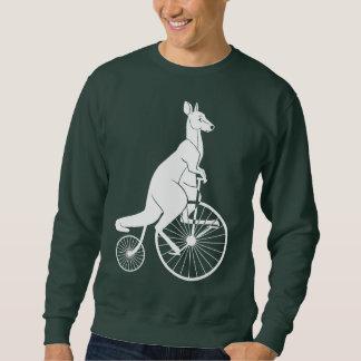 Jinete del canguro en la bici del comino del sudadera