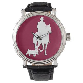 Jinete y caballo elegantes de la silueta del relojes de mano