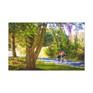 Jinetes de la bici en primavera impresiones en lienzo estiradas