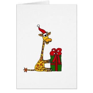 Jirafa divertida en diseño del navidad del gorra tarjeta de felicitación
