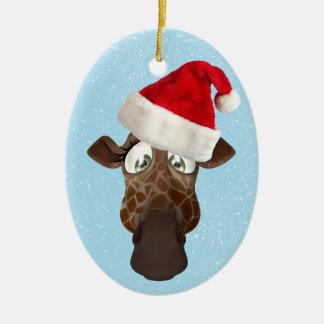 Jirafa divertida linda en el gorra de Santa Adorno Navideño Ovalado De Cerámica