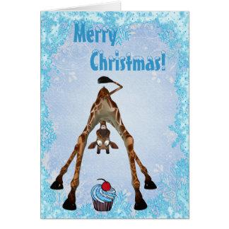 Jirafa divertida y tarjeta de Navidad azul de la m