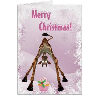 Jirafa divertida y tarjeta de Navidad rosada de la