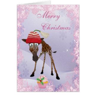 Jirafa linda divertida y tarjeta de Navidad rosada