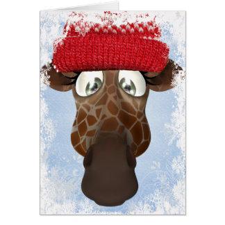 Jirafa linda en tarjeta de Navidad del gorra del i