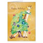 Jirafa que mordisca en el árbol de navidad tarjeton