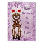 Jirafas debajo de la tarjeta de Navidad púrpura de