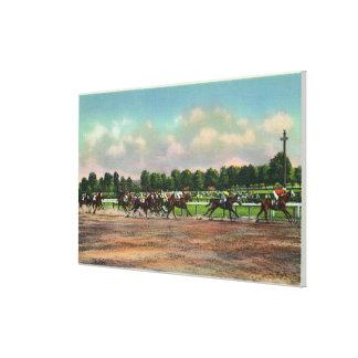 Jockeys Finishing Horse Race at Race Track Canvas Print