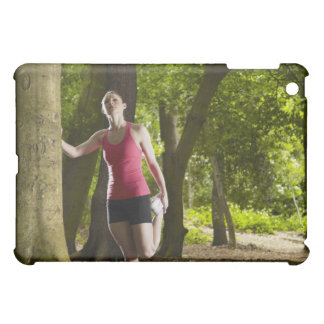 Jogger stretching in forest iPad mini cover