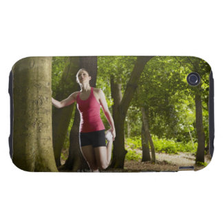 Jogger stretching in forest tough iPhone 3 cases