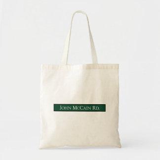 John McCain Road, Road Sign, Texas, USA Bags